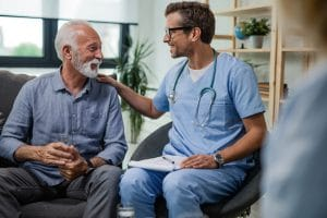 A doctor is meeting with a patient to go over his health.